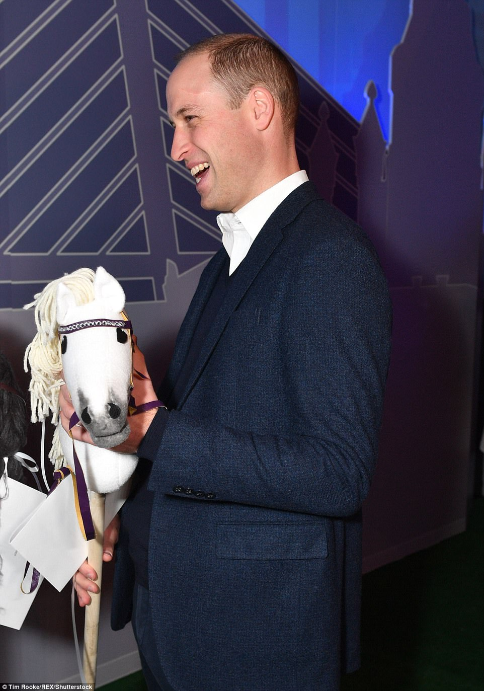 Prince William appeared delighted as he was presented with two hobby horses during a visit to a tech festival in Helsinki on Thursday
