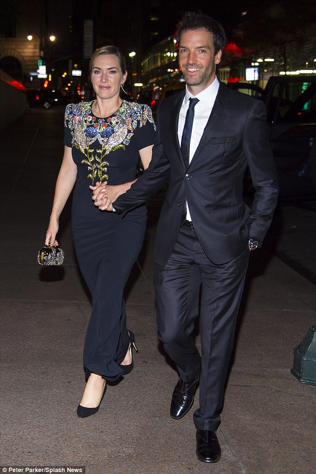 Loved-up: Kate Winslet, 42, looked loved-up more than ever with her husband Ned Rocknroll, 39, as they left a screening of her new flick Wonder Wheel hand-in-hand on Saturday night