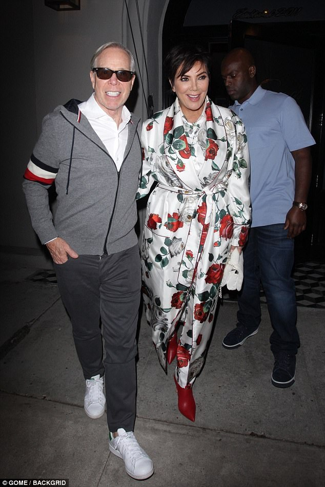 No thorns: The mother of Kim, Khloe and Kourtney Kardashian, as well as Kylie and Kendall Jenner, had on a satin rose print robe over what appeared to be satin rose print pajamas