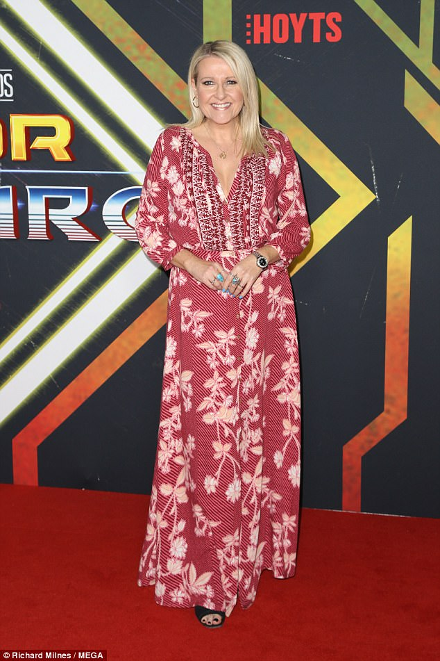 Red carpet regular: Channel Ten entertainment reporter Angela Bishop covered her figure in a vibrant red maxi-dress and accessorised with delicate jewels