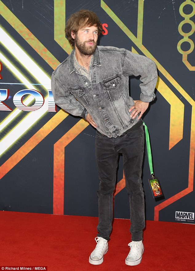 Having the last laugh: Television personality Danny Clayton posed up a storm on the red carpet, and sported an all-denim look