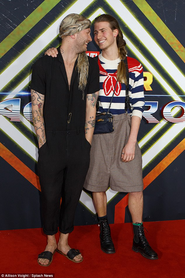 Family affair: Richard's son Christian Wilkins (right) was also on the guest list, showing off a quirky ensemble