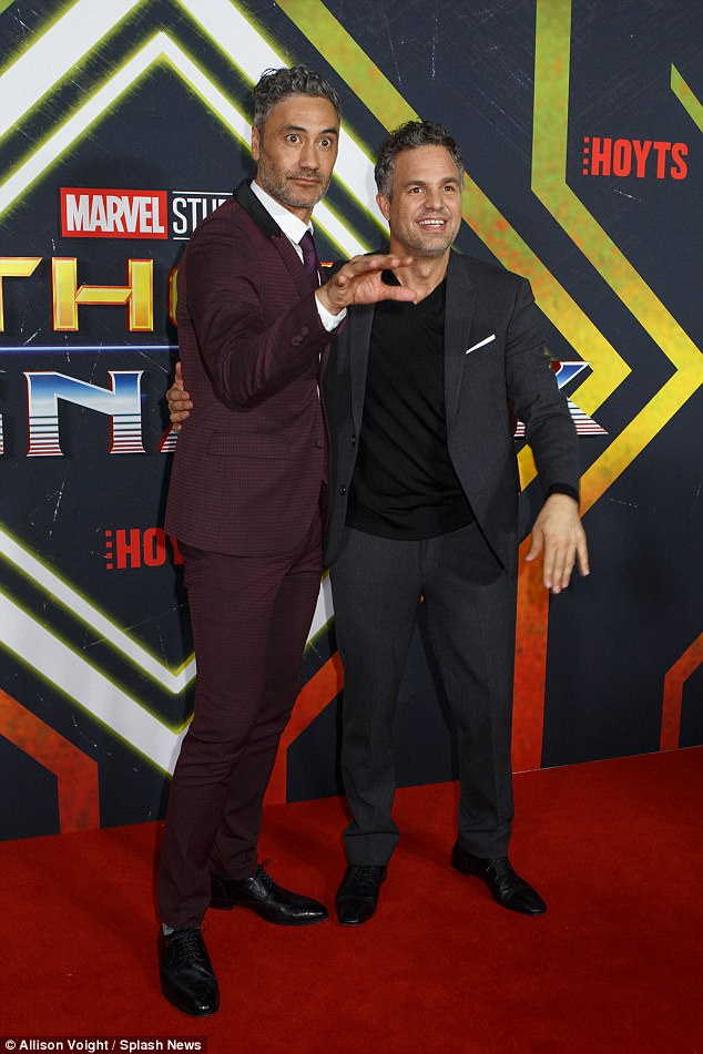 A night to celebrate: The film's director Taika Waititi was also nearby, posing for photos with the high-profile cast