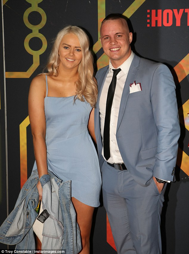 In sync: The couple colour-coordinated, with Johnny opting for a pastel blue suit, and Tahnee, a thigh-skimming frock in a similar hue