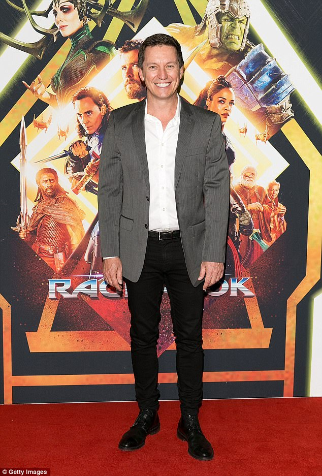 High spirits: Comedian Rove McManus, 43, was all smiles on the red carpet. He sported a white button-up shirt, black trousers, a grey suit jacket and black dress shoes