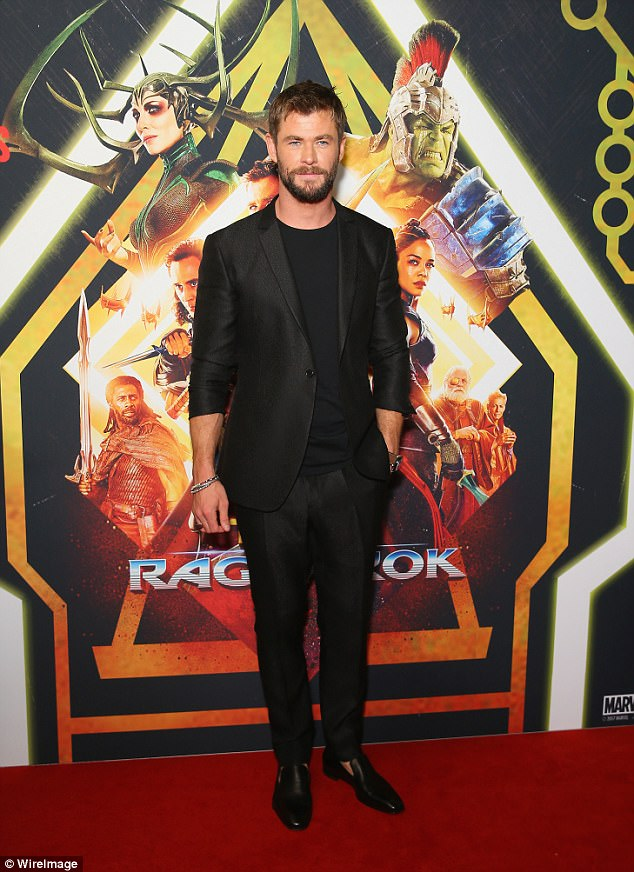 He THOR looks dashing! Chris Hemsworth, 34, cut a suave figure in a tailored suit, as he led the star arrivals at the Sydney premiere for his latest film on Sunday