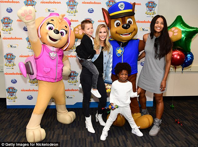 All smiles: The happy family stopped to pose with PAW Patrol characters while at the Nickelodeon event