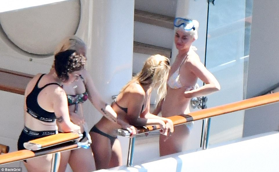 Firm friends:She was seen chatting with a few bikini-clad friends as she enjoyed her time onboard