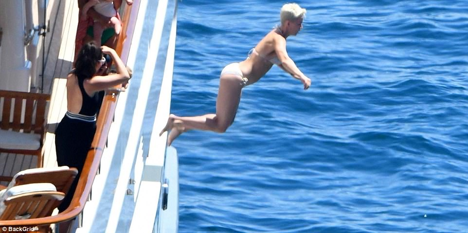 Airborne: Katy looked lithe as she prepared to splash into the water from the deck of the boat