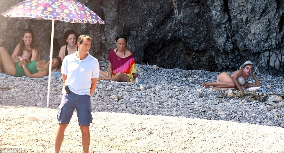 Beach babe: Katy looked like a goddess as she reclined on the pebbles and struck a coy pose