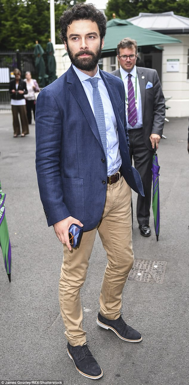 Having a field day:Also in attendance was Poldark hunk Aidan Turner who rocked the classic gentlemanly ensemble for a day at the tennis