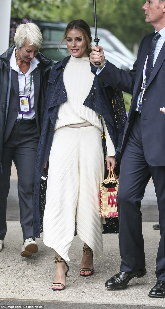 Delighted to be there: Olivia Palermo wowed as she entered in a typically classic look by Burberry