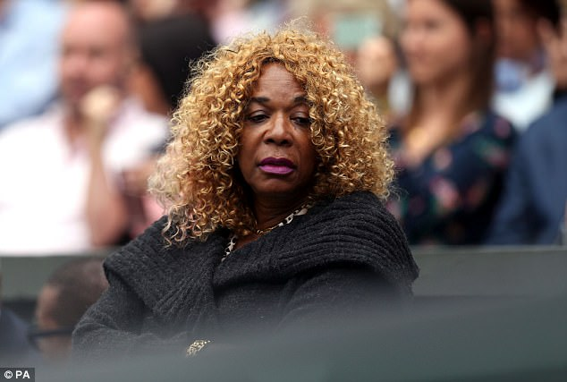 Shattered dreams: Williams' mother Oracene Price looked downcast in the players box on day twelve of the Wimbledon Championships 2017