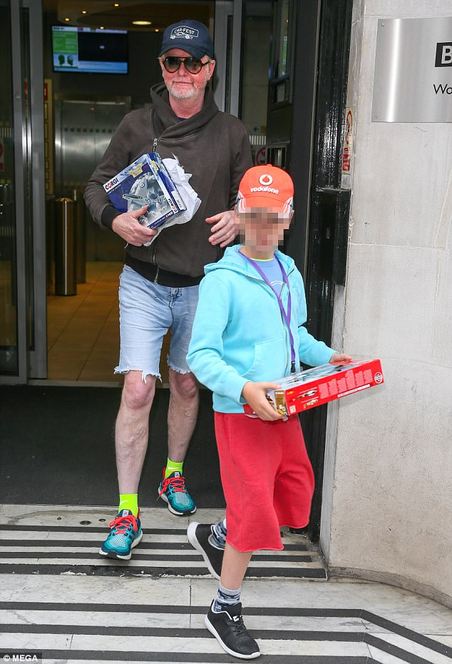 Sweet:Chris Evans seemed keen to pack in plenty of family time as he left the BBC Radio Two studios with his eight-year-old son Noah