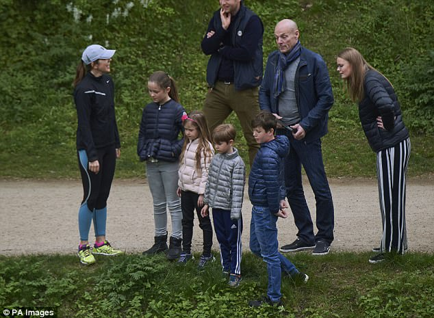 Time for a jog? The Crown Princess appeared to be dressed up for a walk with her children as they wore trainers to the lake
