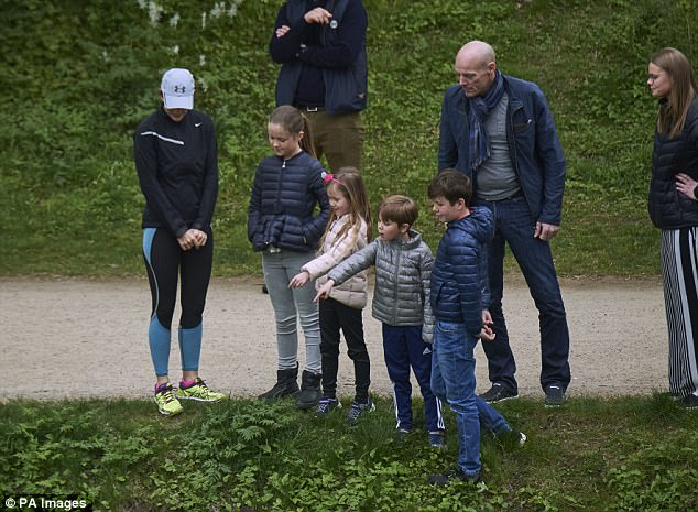 Princess Mary watched on with her children Christian, 11, Isabella, 10, Vincent and Josephine, both six, who anxiously eyed the ducks to make sure they were safe