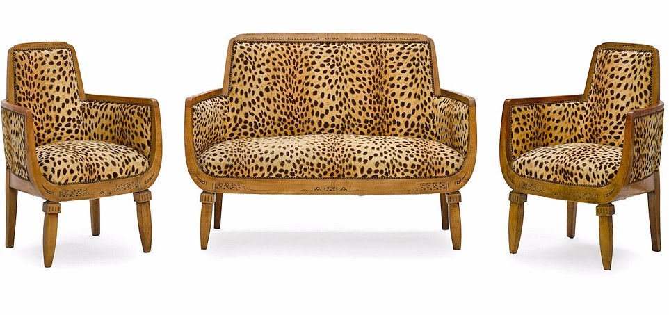 Wild thing: Her eye-catching three piece-suite in leopard print sold for £12,553