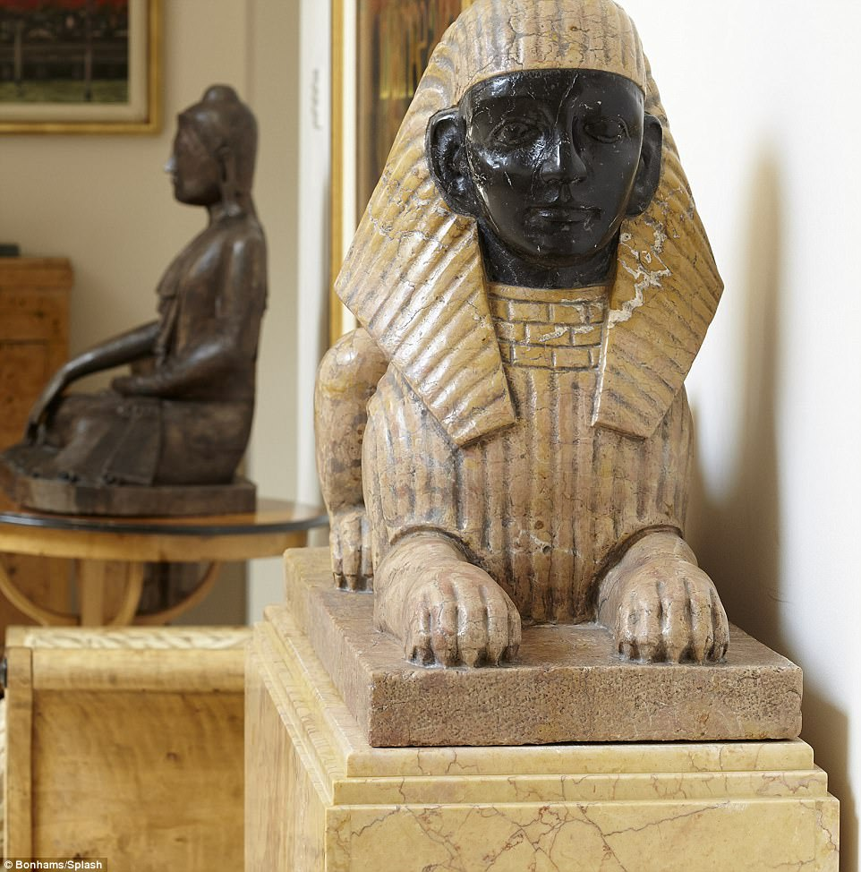 Set in stone: This pair of marble sphinxes were snatched up for a staggering £9,159