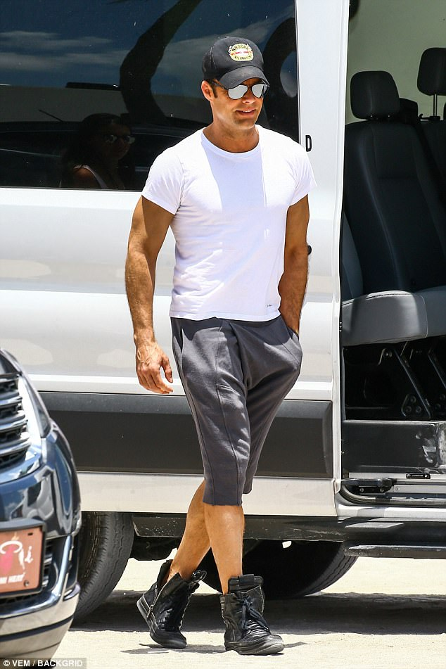 Fit:His tight white Calvin Klein shirt hugged the singer's muscular midsection that drives his fans wild