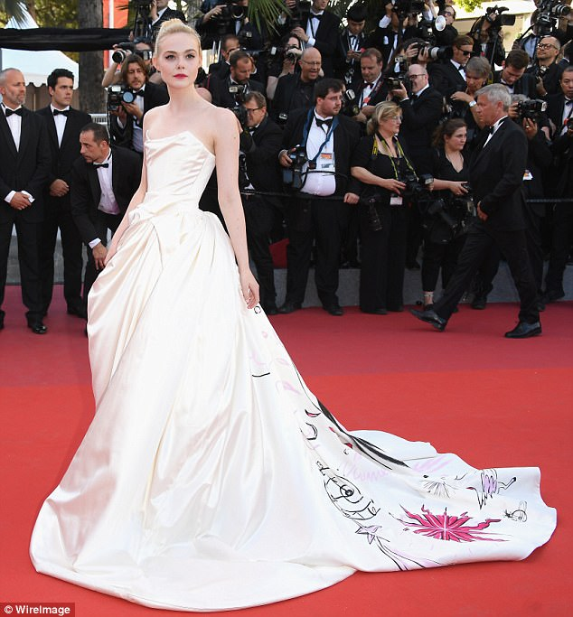 Picture perfect: Elle Fanning, 19, dazzled in a cream colored Vivienne Westwood gown that had unicorn's printed on the back