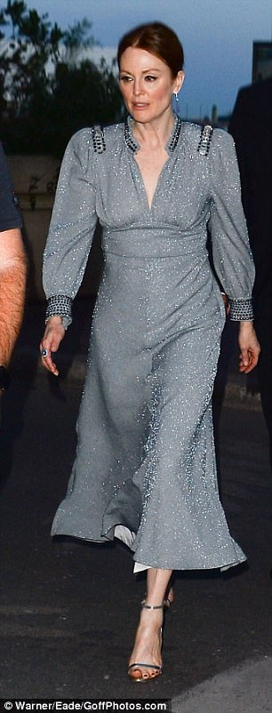 Quick change! Julianne swapped her gown for an equally chic sparkly teal number as she headed to her hotel