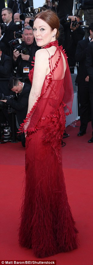 Working her angles: The gorgeous actress chose a spellbinding Givenchy Couture gown as she walked the red carpet at the famed Palais des Festivals