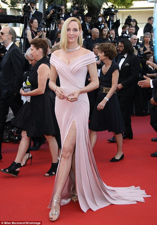 A vision in pink:The 47-year-old actress opted for retro Hollywood glamour as she sizzled in a plunging pink gown from Atelier Versace Fall 2016 Couture which exhibited her eye-popping cleavage while a racy slash made the most of her phenomenally long legs