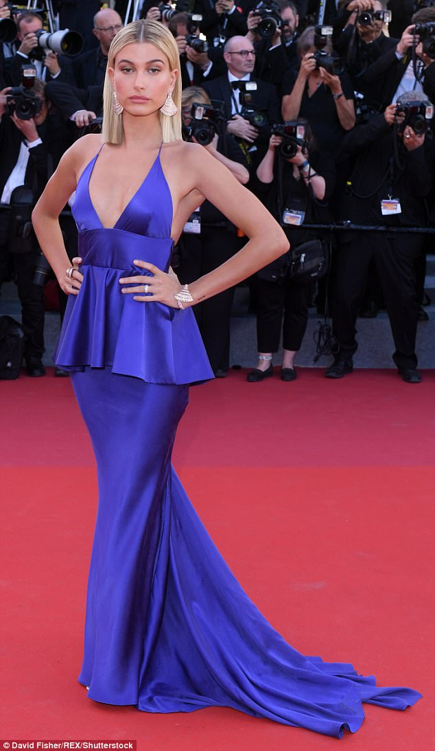 Showstopping: Hailey Baldwin oozed glamour in a plunging deep purple gown as she arrived on the red carpet for the Opening Gala at Cannes Film Festival on Wednesday night
