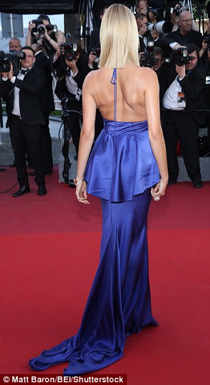 All angles: Ensuring to show off the dress in its full glory, Hailey turned to reveal the low back, with the dress's simple halterneck tie dangling down behind her
