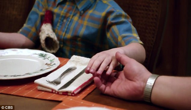 Peace offering: The usually closed-off Sheldon holds hands with his father for the first time at the end of the clip