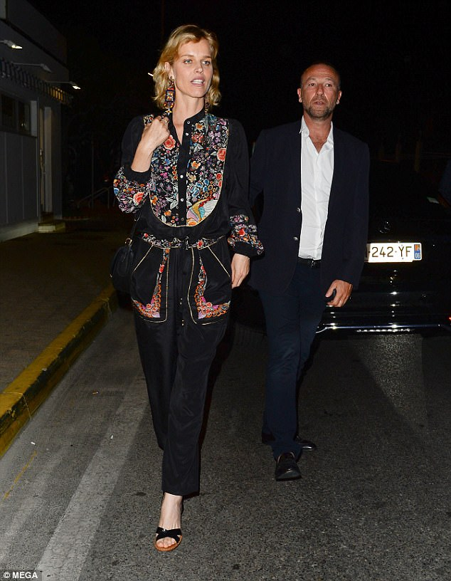 Casual glamour: Eva donned a heavily printed blouse, which she paired with slim-leg black denims and casual heels