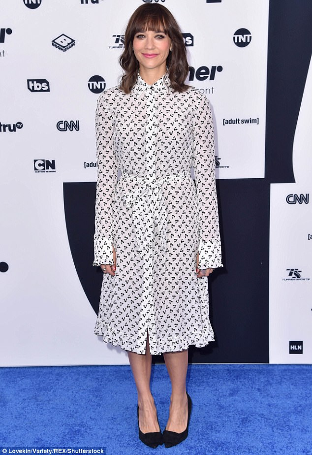 Natural beauty:Rashida Jones slipped on a patterned button up dress in black and white tones