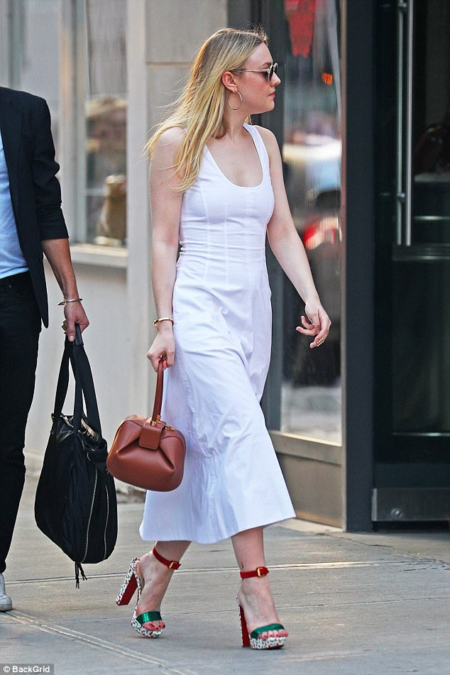 Quick change: The actress changed into a white dress paired with red and green heels and a camel handbag