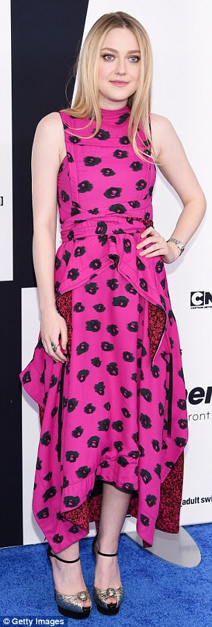 Elegant arrival:The 23-year-old stood out in her colorful pink and black dress featuring an asymmetrical skirt