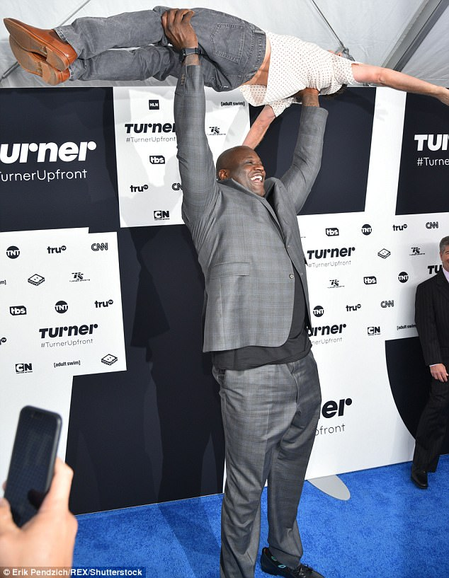 He makes it look easy:The Inside The NBA analyst lifted actor Breckin Meyer playfully in the air