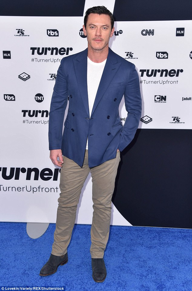 Looking good: Beauty and The Beast actor Luke Evans cut a stylish figure in his cobalt blue blazer with cream trousers and a classic white T-shirt