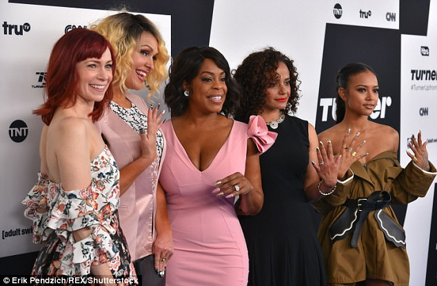 Look at their nails: Karrueche, 28, looked pretty in the khaki colored look - which is actually a jacket; pictured with Claws co-stars Carrie Preston, Jenn Lyon, Judy Reyes, Niecy Nash