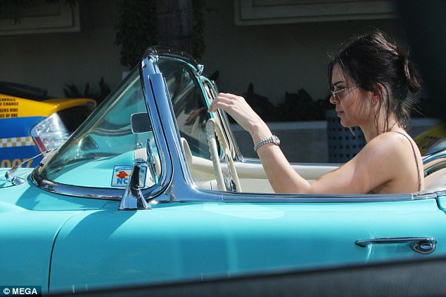Getting fans into a spin! Kendall Jenner, 21, certainly stole the limelight as she was spotted cruising through Beverly Hills in a vintage Chevrolet on Sunday