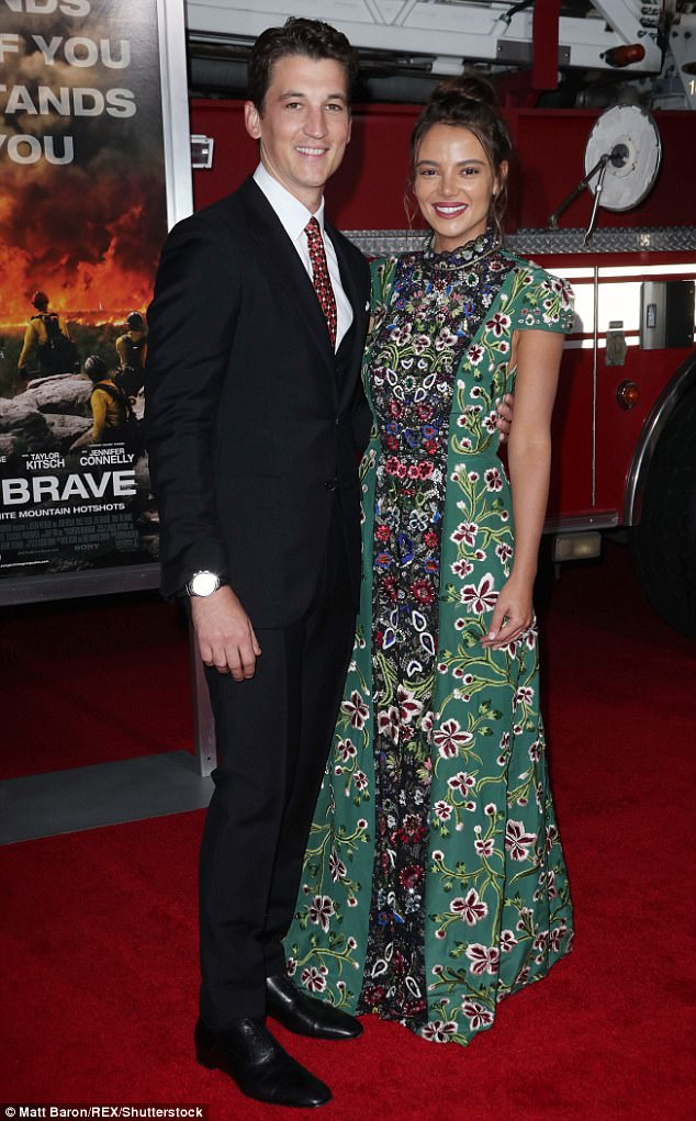 Look of love? Miles Teller and new fiancee Keleigh Sperry seem to need a bit of practice before the wedding day as they fumbled over a kiss on the red carpet of Only The Brave on Sunday night in Los Angeles