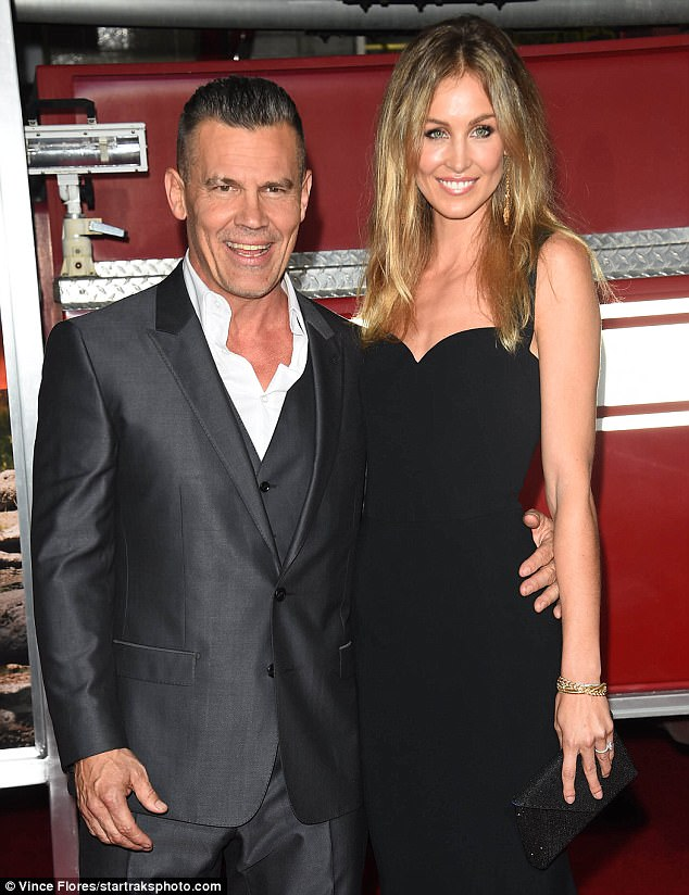 Red carpet ready: The actor, 49, looking dapper in a bespoke three-piece charcoal suit, and his two decades younger spouse put on a loved up display as they posed for photos