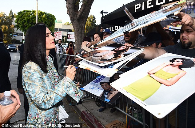 People pleaser: The actress proved to be quite the social butterfly as she signed autographs for waiting fans
