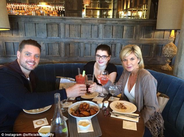 Keith enjoys birthday cocktails with his daughter Mia and wife Lisa. The former Boyzone star was initially 'distraught' when his daughter was diagnosed with autism at 18 months old