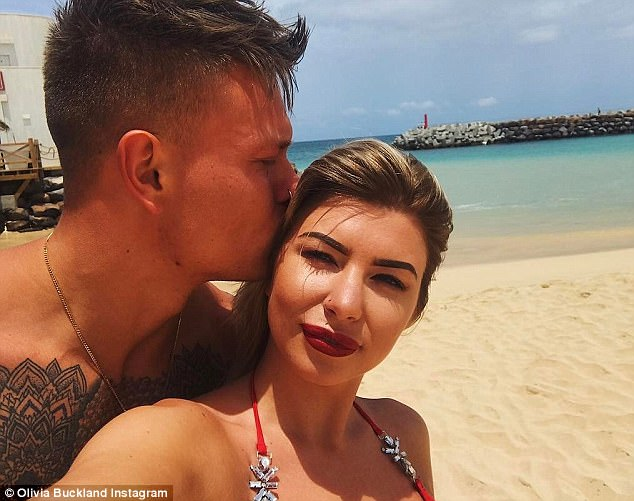 Heartwarming:Olivia had once again melted the hearts of her 1.1 million followers with a beach shot of her fiancé tenderly kissing her cheek