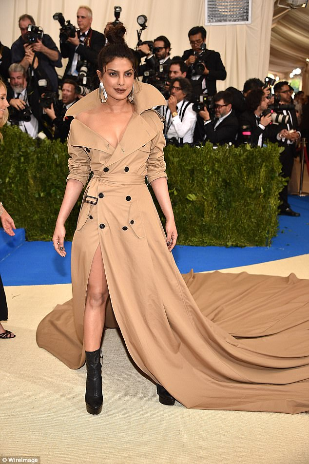 Glamorous: The actress attended the Met Gala in New York on Monday, wearing a dramatic Ralph Lauren trench coat on the red carpet