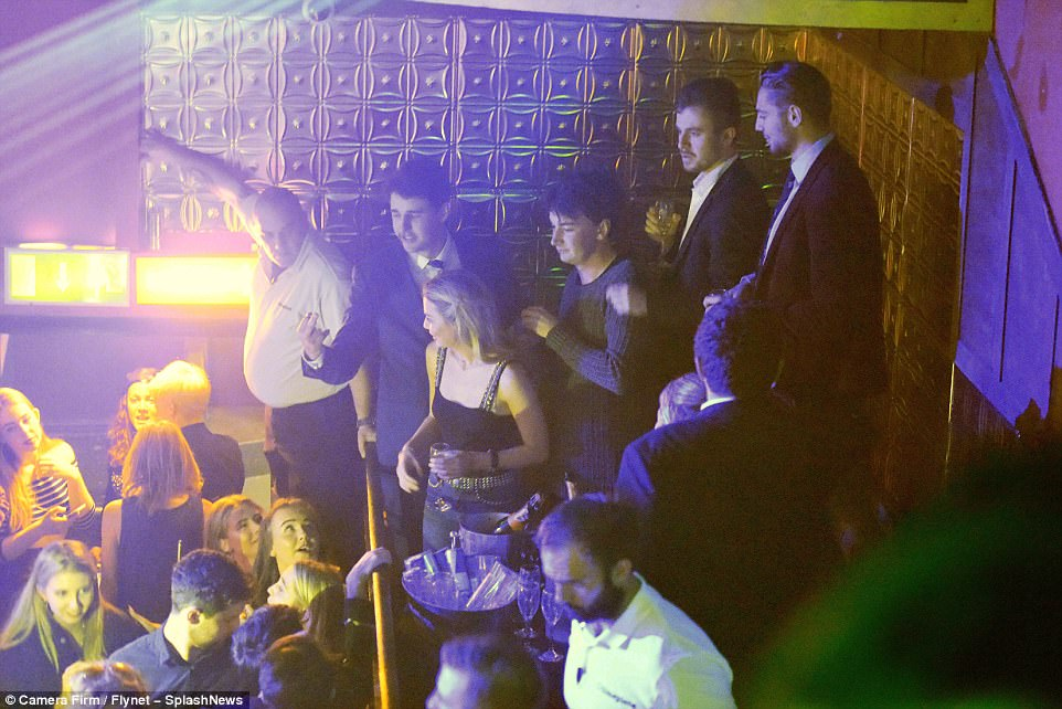 All hail the Queen: Fellow party-goers could not help but stare at Toff as she enjoyed a night out in the VIP area with her friends