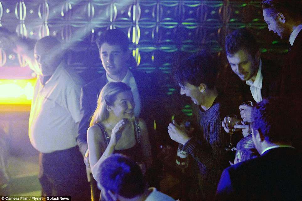 Having a ball: Toff had her friends in stitches as she chatted to them in the club - no doubt telling funny stories from her time in the jungle