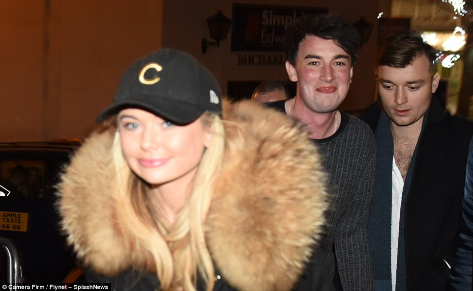 Feeling good: Toff flashed a smile at cameras as she headed home with her friends