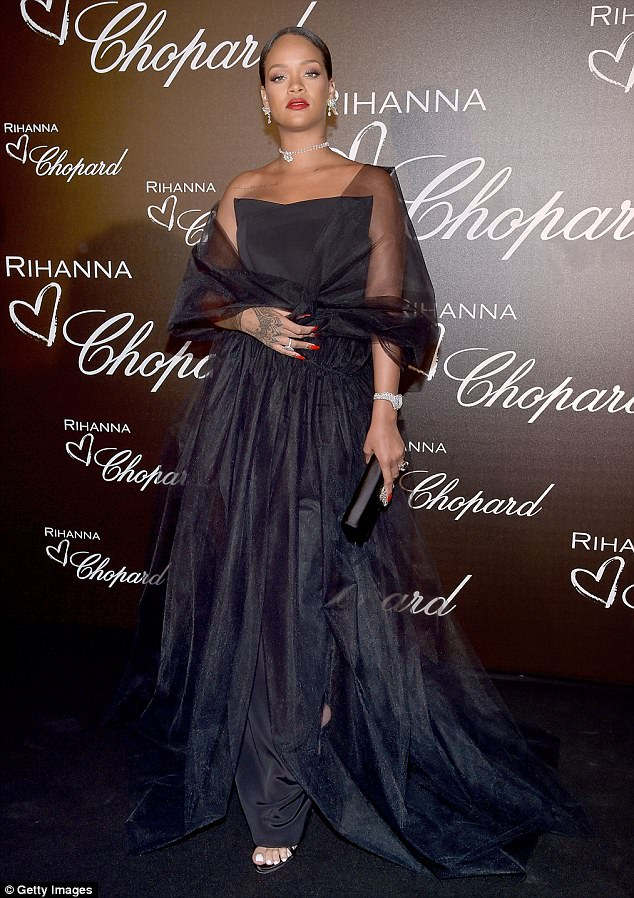 Glamour:Rihannaexuded old-school Hollywood glamour in a black tulle gownas she attended a dinner celebrating her collaboration with Chopard in Cannes on Thursday night