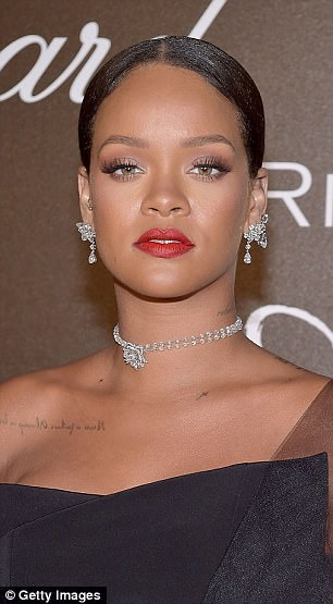 Beauty:Wearing her lengthy tresses in a elegant up' do, she added a pop of colour with a bold red lipstick, before adding lashings of mascara to finish