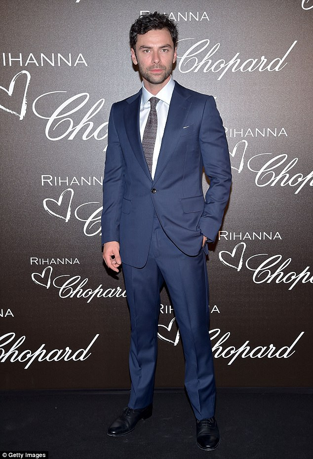 Looking dapper: Aidan Turner opted for a sharp navy suit as he attended the dinner